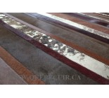 100579 G Cowhide patchwork rug made with strips.