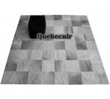 Grand tapis patchwork  en peau de vache. 650335