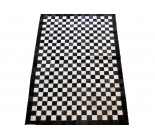 Cowhide Rug Patchwork Textured With Small Holes. Black And White